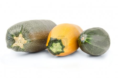Zucchini vegetables, yellow and green on a white background
