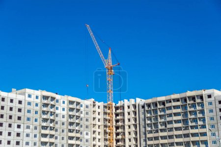 New highrise building and industrial cranes