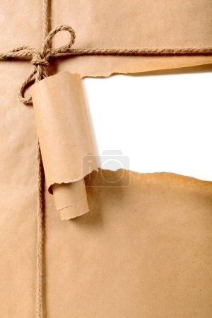 Photo pour Papier brun déchiré fond de paquet - image libre de droit