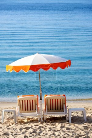 Photo for Beach umbrella and lounger - Royalty Free Image