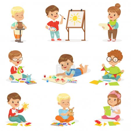 Little Kids In Art Class In School Doing Different Creative Activities, Painting , Working With Putty And Cutting Paper.