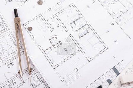 Photo for Workplace of architect. Engineering blueprint and divider for creating new architectural project on table, copy space - Royalty Free Image