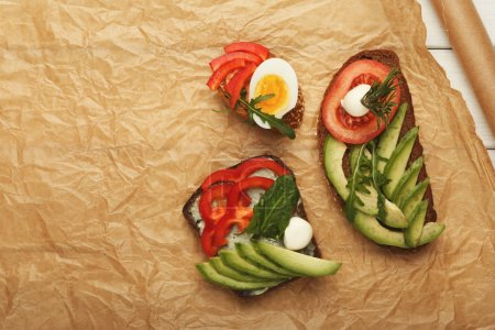 Photo for Vegetarian wholegrain sandwiches with micro greens. Vegan party food table with organic vegetables canapes. Healthy lifestyle and eating right concept, top view, copy space - Royalty Free Image