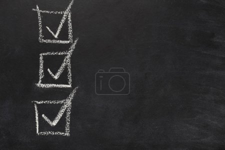 Photo for Three marked checkboxes on blackboard. Checklist template drawn with chalk. Choice, analisys, vote conceptual background, copy space, top view - Royalty Free Image