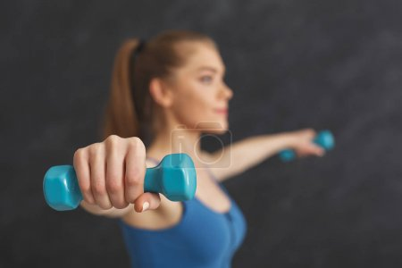 Photo for Strong fitness woman training with dumbbells at gym, doing strength exercise for biceps, bodybuilding concept, copy space - Royalty Free Image