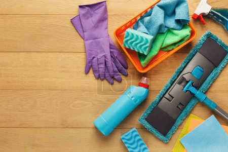 Photo for House cleaning products and supplies on wooden background, top view. Spring cleaning and household concept. Mockup for advertisement with copy space - Royalty Free Image