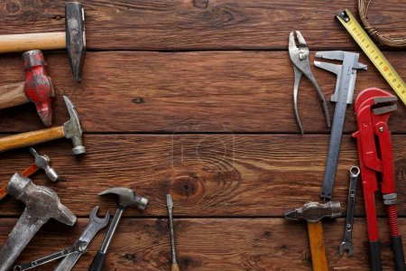 Photo for Different repair tools and equipment on wood background with copy space, top view - Royalty Free Image