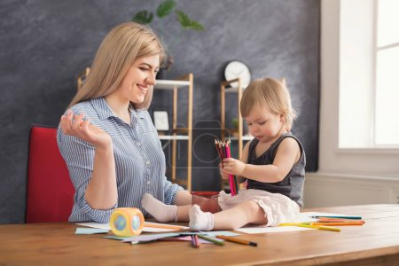 Photo for Happy mother choosing pencils and drawing with her cute daughter. Relationship, motherhood, trust, support, caress, maternal warmth, caring, education and early development concept - Royalty Free Image