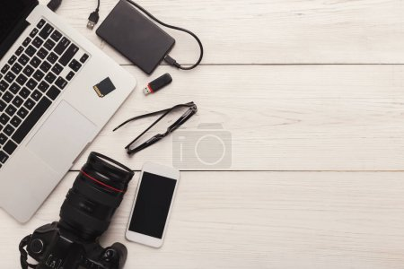 Photo for Set of modern photographic equipment on white wooden table, top view. Professional tools of creative designer frame, photographer workplace background, copy space - Royalty Free Image