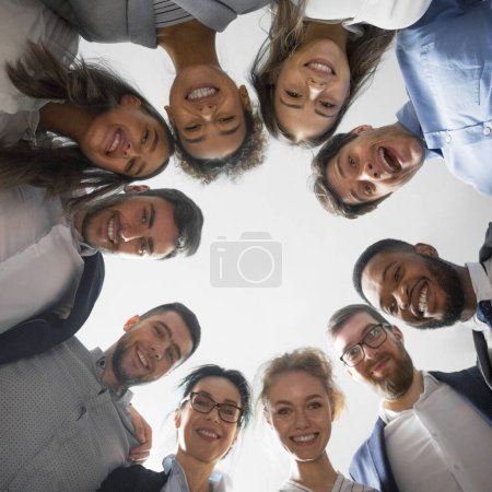 Happy diverse business people standing in circle