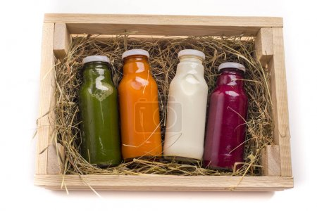 Photo pour Set of healthy colored detox drinks in wooden box on white background - image libre de droit