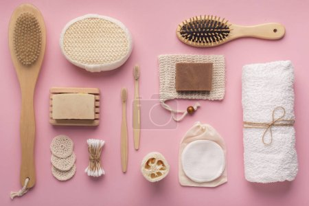 Photo pour Creative flat lay of natural spa accessories with cocoa soap on pink background - image libre de droit
