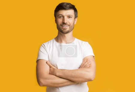 Photo for Positive Middle Aged Man Smiling Crossing Hands Posing Over Yellow Background. Studio Shot, Empty Space - Royalty Free Image