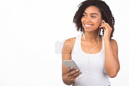 Photo pour Favorite Song. Calm black girl wearing headphones listening to modern music isolated on white background, copyspace - image libre de droit