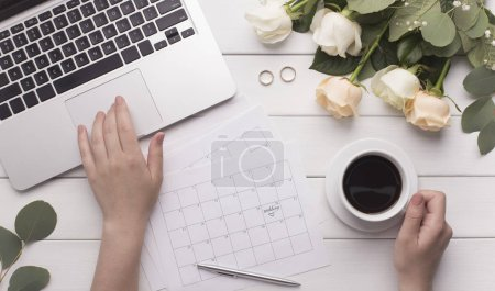 Photo for Wedding arrangement background. Female hands preparing for marriage, using laptop, paper calendar - Royalty Free Image
