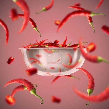 Photo pour Concept de nourriture épicée. Piment fort sur fond rouge. Composition volante du bol - image libre de droit