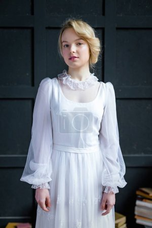 Woman in white vintage dress