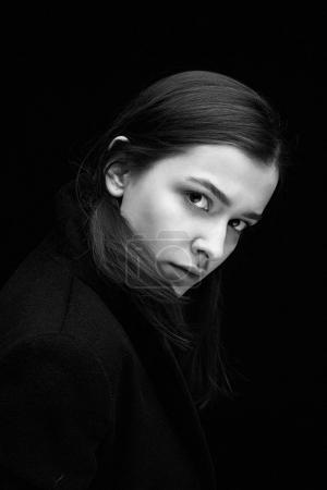 Photo for Portrait of gorgeous fashion model against dark studio background - Royalty Free Image