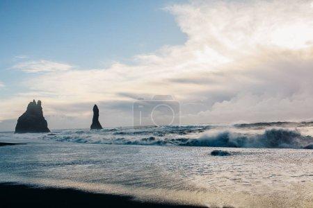 Seashore over rocky mountains