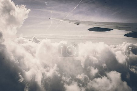 clouds with wing of airplane