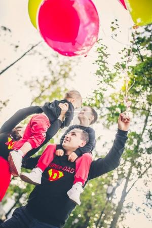 lovely family in park with balloons