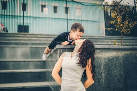 lovely mother and son on city stairs