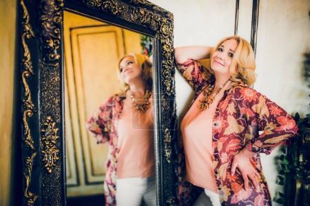 woman near vintage mirror