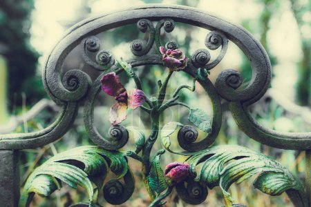 close-up of vintage metal gates with flowers at Munich cemetery in Germany