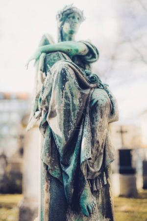 close-up of old Angel monument at Munich cemetery in Germany