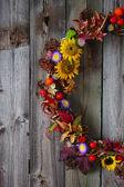 """Постер, картина, фотообои """"Осенний венок с цветами живых и сухих цветов"""""""