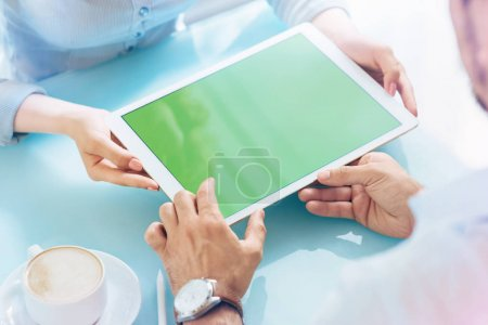 Photo for Man and woman discussing a project showing it with tablet pc. Clipping path included. - Royalty Free Image