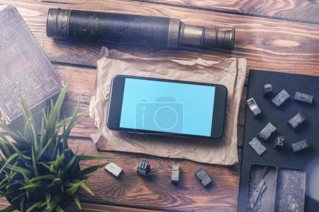 Photo for Top view smartphone mock-up on table next to vintage accessories. Clipping path - Royalty Free Image