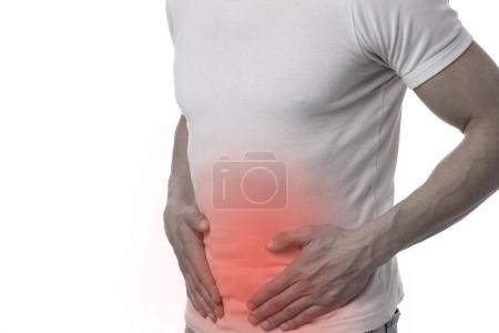 Photo for Man with stomach pain. Digestive system, Urinary Tract Infection problems. - Royalty Free Image