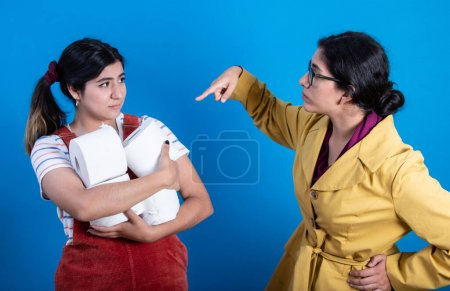 A pair of women fighting for TP (toilet paper) ami...
