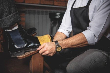 artisans hand cleaning the leather shoes