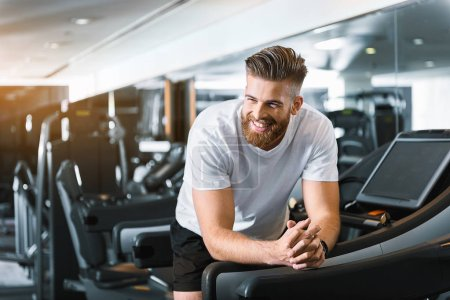 Happy smiling man in gym