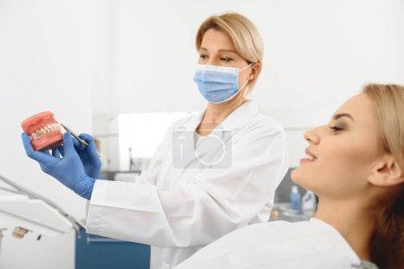 Dentist explaining construction of mouth cavity