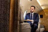 Serene gentleman using private jet