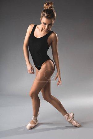 Full length of slim calm ballet dancer standing in...