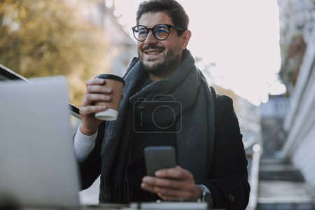 Photo for Attractive Caucasian guy drinking tea. Business concept - Royalty Free Image