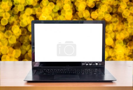 Photo for Laptop computer  over light bokeh background - Royalty Free Image