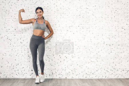 Photo for Sport woman in sportswear relax stand after workout against copy space for adding text with white wall background.Diet concept.Fitness and healthy lifestyle - Royalty Free Image