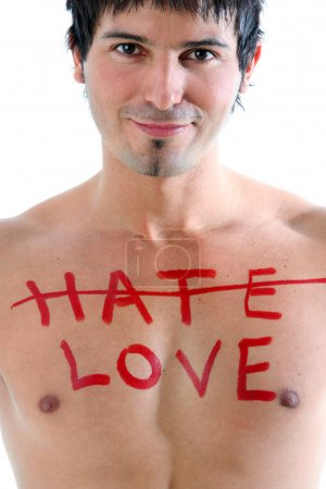 shirtless man with word love on chest