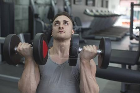 Man weightlifting dumbbells