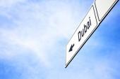 Signboard pointing towards Dubai