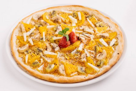 Sweet pizza with fruits on table