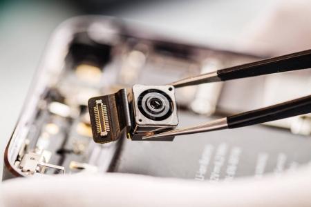 Repairing Damaged Smart Phone in service center. closeup