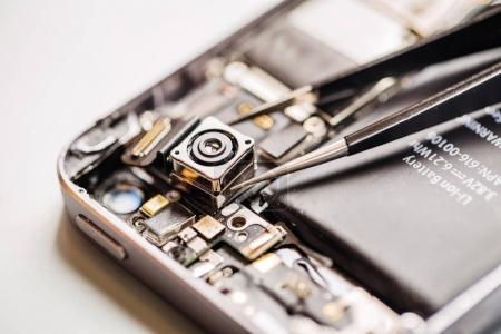 Photo for Repairing Damaged Smart Phone in service center. Repairing and service concept. closeup - Royalty Free Image