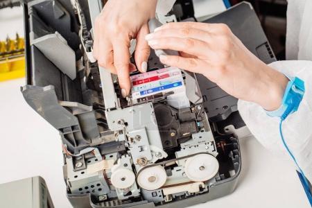 closeup shot young female technician repairing digital printer