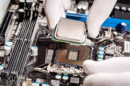 technicial install cpu chip to mainboard computer